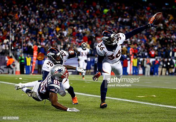 Cornerback Kayvon Webster of the Denver Broncos blocks a pass intended for wide receiver Kenbrell Thompkins of the New England Patriots during a game...