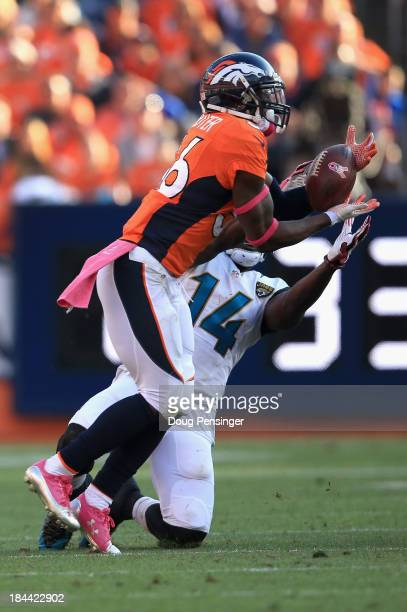 Cornerback Kayvon Webster of the Denver Broncos intercepts a pass by quarterback Chad Henne of the Jacksonville Jaguars intended for wide receiver...