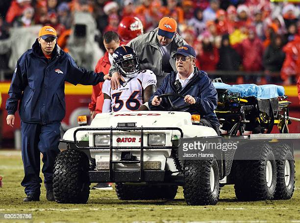 Cornerback Kayvon Webster of the Denver Broncos is carted off the field after an injury during the game against the Kansas City Chiefs at Arrowhead...