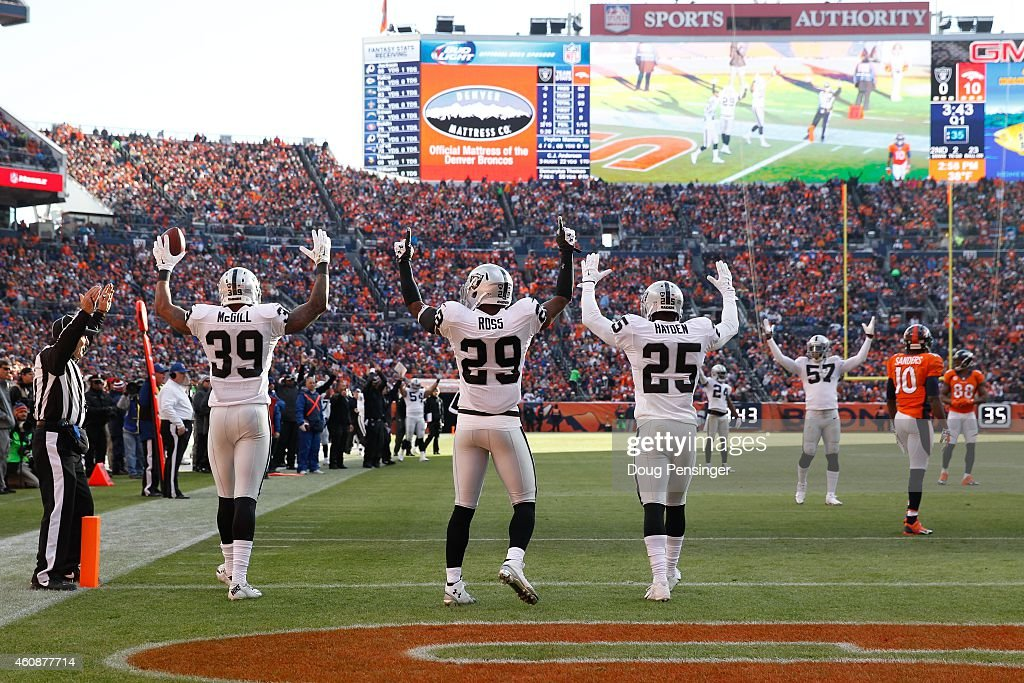 Cornerback Keith McGill strong safety Brandian Ross and cornerback DJ Hayden of the Oakland Raiders celebrate a touchdown against the Denver Broncos...