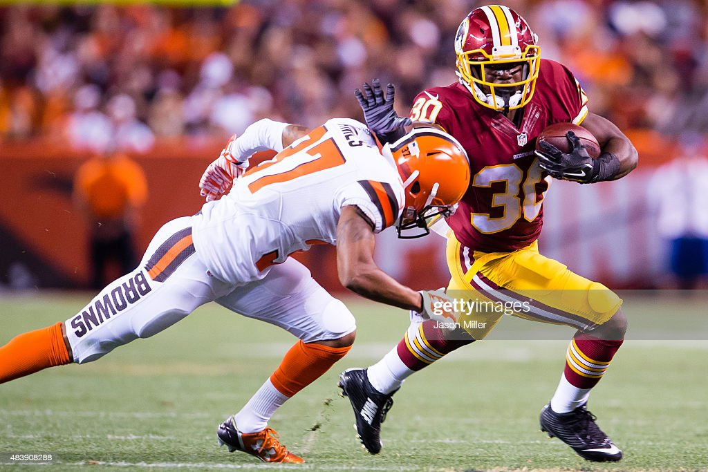 Cornerback Kendall James #37 of the Cleveland Browns tackles strong safety Kyshoen Jarrett #30 of the Washington Redskins during the second half at FirstEnergy Stadium on August 13, 2015 in Cleveland, Ohio. The Redskins defeated the Browns 20-17.
