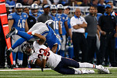 Cornerback Kyle Fuller of the Chicago Bears tackles running back Ameer Abdullah of the Detroit Lions during the NFL game at Ford Field on October 18...
