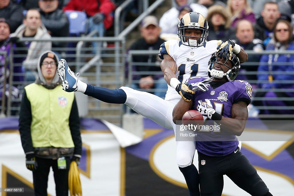 Cornerback <a gi-track='captionPersonalityLinkClicked' href=/galleries/search?phrase=Lardarius+Webb&family=editorial&specificpeople=5735454 ng-click='$event.stopPropagation()'>Lardarius Webb</a> #21 of the Baltimore Ravens breaks up a pass intended for wide receiver <a gi-track='captionPersonalityLinkClicked' href=/galleries/search?phrase=Tavon+Austin&family=editorial&specificpeople=6543303 ng-click='$event.stopPropagation()'>Tavon Austin</a> #11 of the St. Louis Rams in the second quarter at M&T Bank Stadium on November 22, 2015 in Baltimore, Maryland.