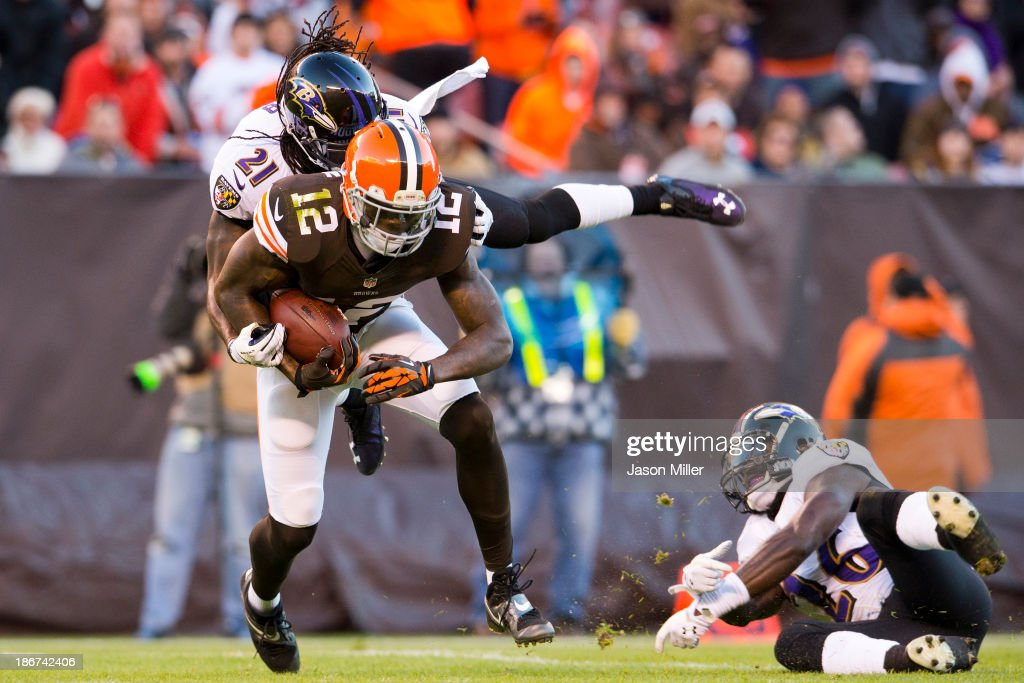 Cornerback Lardarius Webb #21 of the Baltimore Ravens tackles wide receiver Josh Gordon #12 of the Cleveland Browns who makes the reception for a first down during the first half at FirstEnergy Stadium on November 3, 2013 in Cleveland, Ohio.