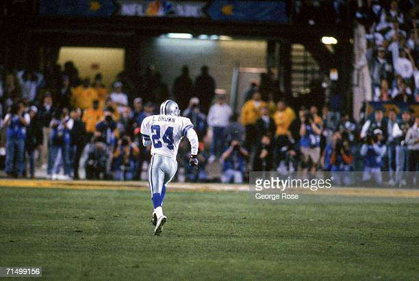 Cornerback Larry Brown of the Dallas Cowboys returns an interception for a forty four yard touchdown return during Super Bowl XXX against the...