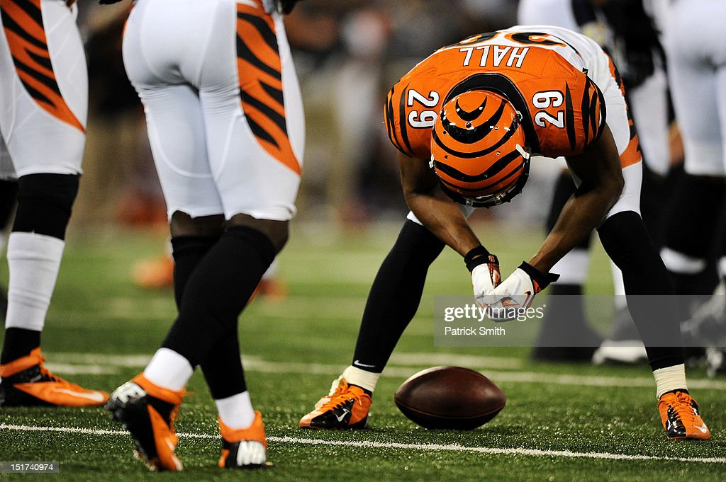 Cornerback <a gi-track='captionPersonalityLinkClicked' href=/galleries/search?phrase=Leon+Hall&family=editorial&specificpeople=223989 ng-click='$event.stopPropagation()'>Leon Hall</a> #29 of the Cincinnati Bengals ducks his head after missing an interception against the Baltimore Ravens in the second quarter at M&T Bank Stadium on September 10, 2012 in Baltimore, Maryland. The Baltimore Ravens won, 44-13.