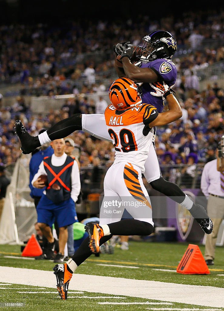 Cornerback <a gi-track='captionPersonalityLinkClicked' href=/galleries/search?phrase=Leon+Hall&family=editorial&specificpeople=223989 ng-click='$event.stopPropagation()'>Leon Hall</a> #29 of the Cincinnati Bengals pushes wide receiver Deonte Thompson #83 of the Baltimore Ravens out of bounds for an incomplete pass during the second half at M&T Bank Stadium on September 10, 2012 in Baltimore, Maryland.
