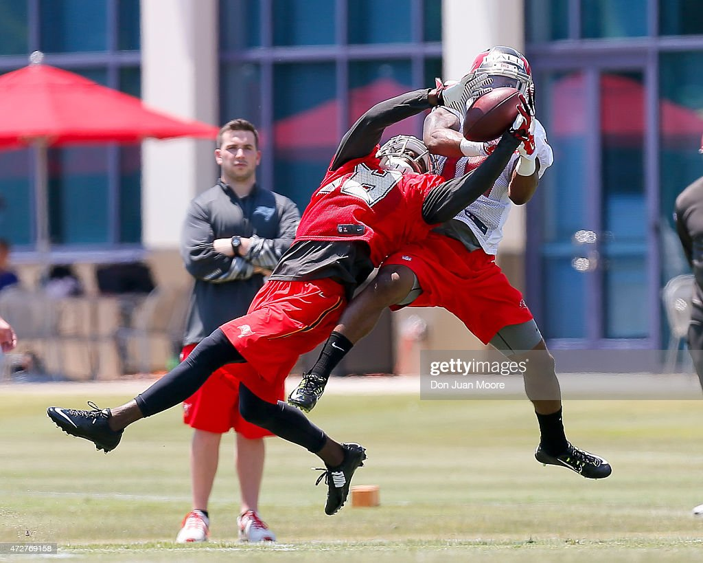 Cornerback Lowell Rose #28 intercepted the ball from Wide Receiver Rannell Hall #16 of the Tampa Bay Buccaneers during Rookie Mini Camp at One Buccaneer Place on May 9, 2015 in Tampa, Florida.
