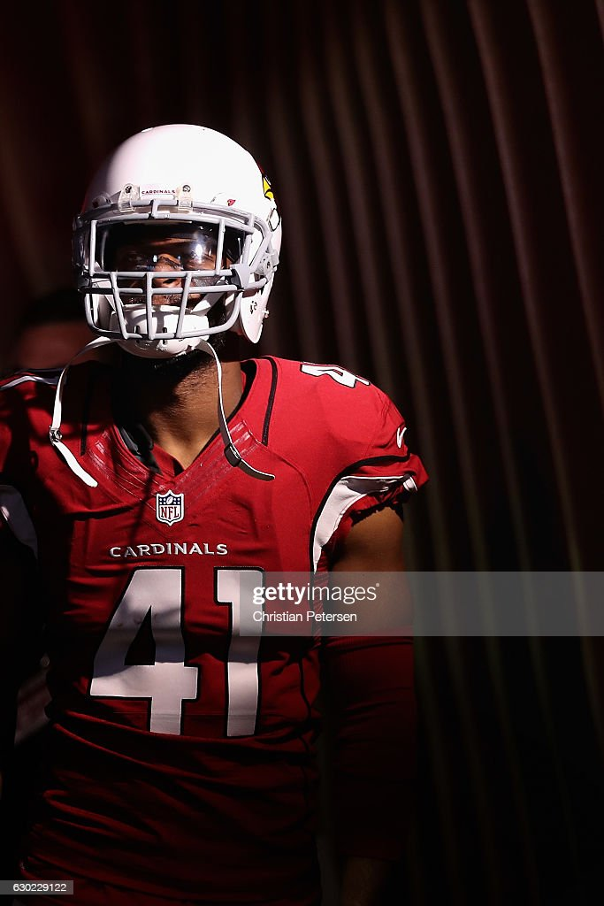 Cornerback Marcus Cooper #41 of the Arizona Cardinals stands in the tunnel before the NFL game against the New Orleans Saints at the University of Phoenix Stadium on December18, 2016 in Glendale, Arizona. The Saints defeated the Cardinals 48-41.