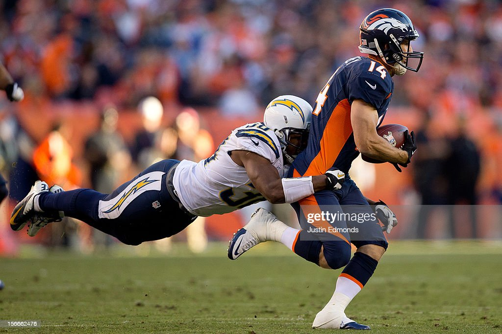 Cornerback Marcus Gilchrist of the San Diego Chargers makes a diving tackle after a reception by wide receiver Brandon Stokley of the Denver Broncos...