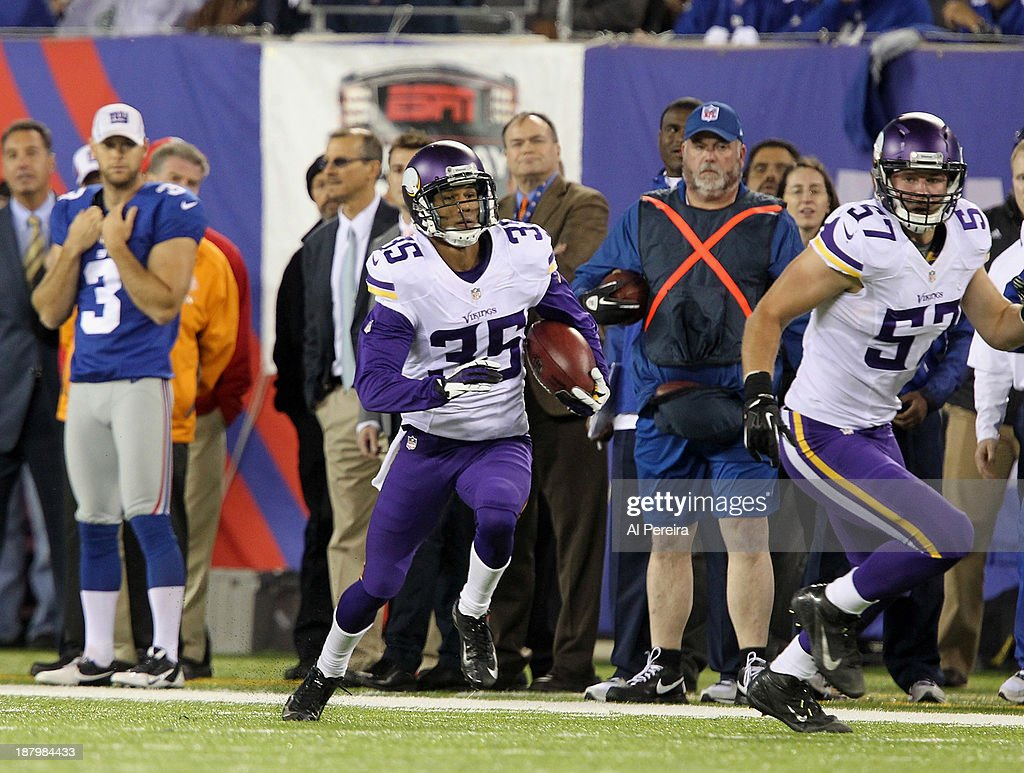 Cornerback Marcus Sherels of the Minnesota Vikings has a punt return for a Touchdown the New York Giants at MetLife Stadium on October 21 2013 in...