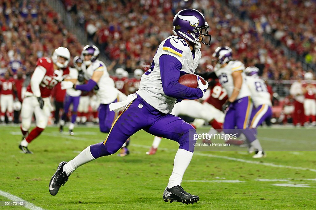 Cornerback Marcus Sherels of the Minnesota Vikings returns a kick off during the NFL game against the Arizona Cardinals at the University of Phoenix...