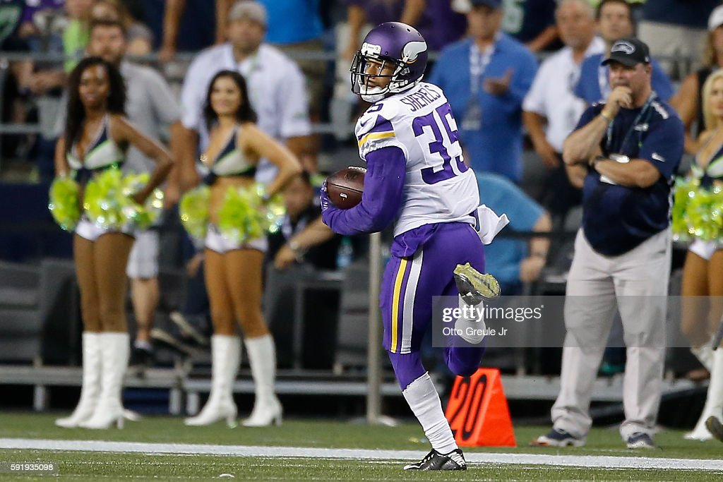Cornerback Marcus Sherels of the Minnesota Vikings returns an interception for a touchdown against the Seattle Seahawks at CenturyLink Field on...