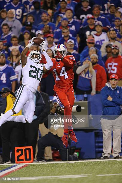 Cornerback Marcus Williams of the New York Jets has an interception in front of Wide Receiver Sammy Watkins of the Buffalo Bills at Ralph Wilson...