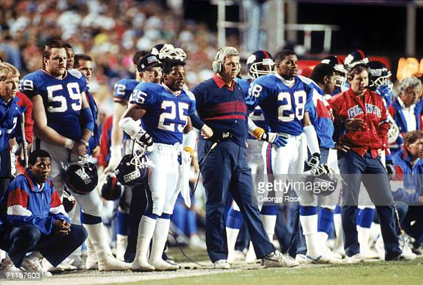 Cornerback Mark Collins head coach Bill Parcells cornerback Everson Walls and assistant coach Bill Belichick of the New York Giants stand on the...