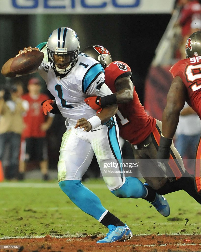 Cornerback Michael Adams #21 of the Tampa Bay Buccaneers sacks quarterback <a gi-track='captionPersonalityLinkClicked' href=/galleries/search?phrase=Cam+Newton+-+American+Football+Quarterback&family=editorial&specificpeople=4516761 ng-click='$event.stopPropagation()'>Cam Newton</a> #1 of the Carolina Panthers October 24, 2013 at Raymond James Stadium in Tampa, Florida. Carolina won 31 - 13.