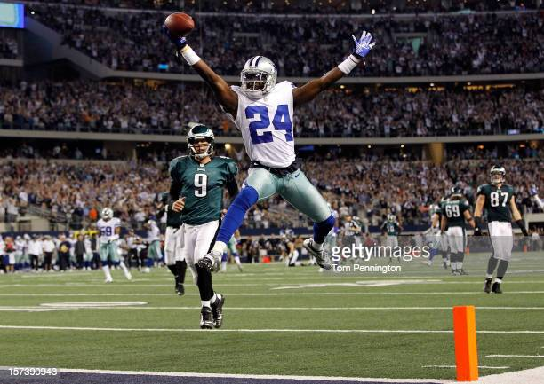 Cornerback Morris Claiborne of the Dallas Cowboys celebrates while crossing the goal line to score on a fumble recovery as quarterback Nick Foles of...