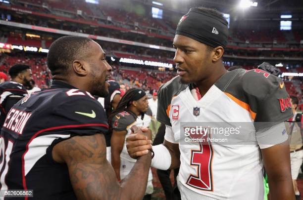 Cornerback Patrick Peterson of the Arizona Cardinals and quarterback Jameis Winston of the Tampa Bay Buccaneers following the NFL game at the...