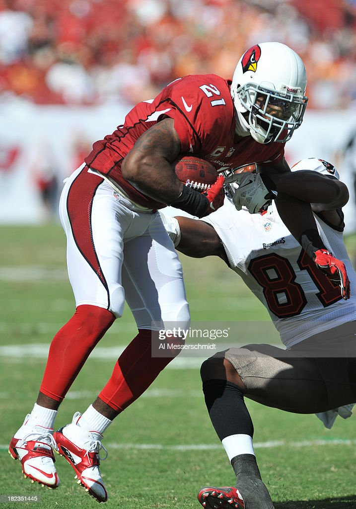 Cornerback <a gi-track='captionPersonalityLinkClicked' href=/galleries/search?phrase=Patrick+Peterson&family=editorial&specificpeople=5582456 ng-click='$event.stopPropagation()'>Patrick Peterson</a> #21 of the Arizona Cardinals intercepts a pass in the 4th quarter against the Tampa Bay Buccaneers September 29, 2013 at Raymond James Stadium in Tampa, Florida. Peterson later intercepted another pass and Arizona won 13 - 10.