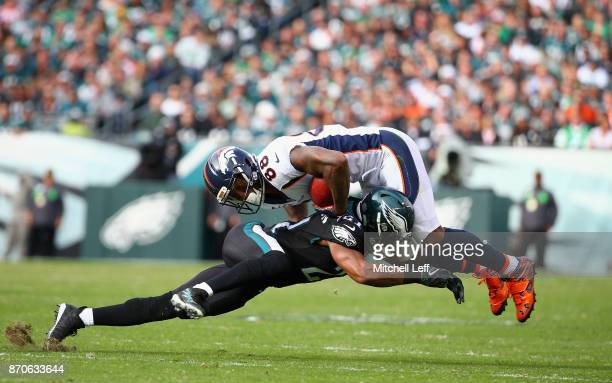 Cornerback Patrick Robinson of the Philadelphia Eagles tackles wide receiver Demaryius Thomas of the Denver Broncos during the second quarter at...