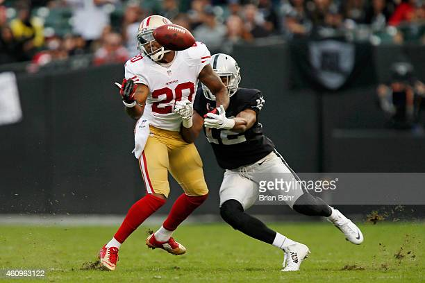 Cornerback Perrish Cox of the San Francisco 49ers breaks up a pass intended for Brice Butler of the Oakland Raiders in the third quarter on December...