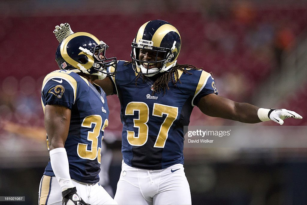 Cornerback Quinton Pointer #33 of the St. Louis Rams celebrates with safety Matt Daniels #37 after breaking up a catch during the game against the Baltimore Ravens at the Edward Jones Dome on August 30, 2012 in St. Louis, Missouri. The St. Louis Rams defeated the Baltimore Ravens 31-17.