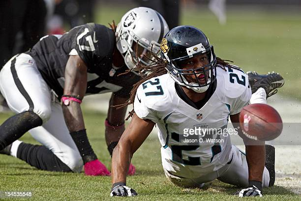 Cornerback Rashean Mathis of the Jacksonville Jaguars is penalized for defensive pass interference on wide receiver Denarius Moore of the Oakland...