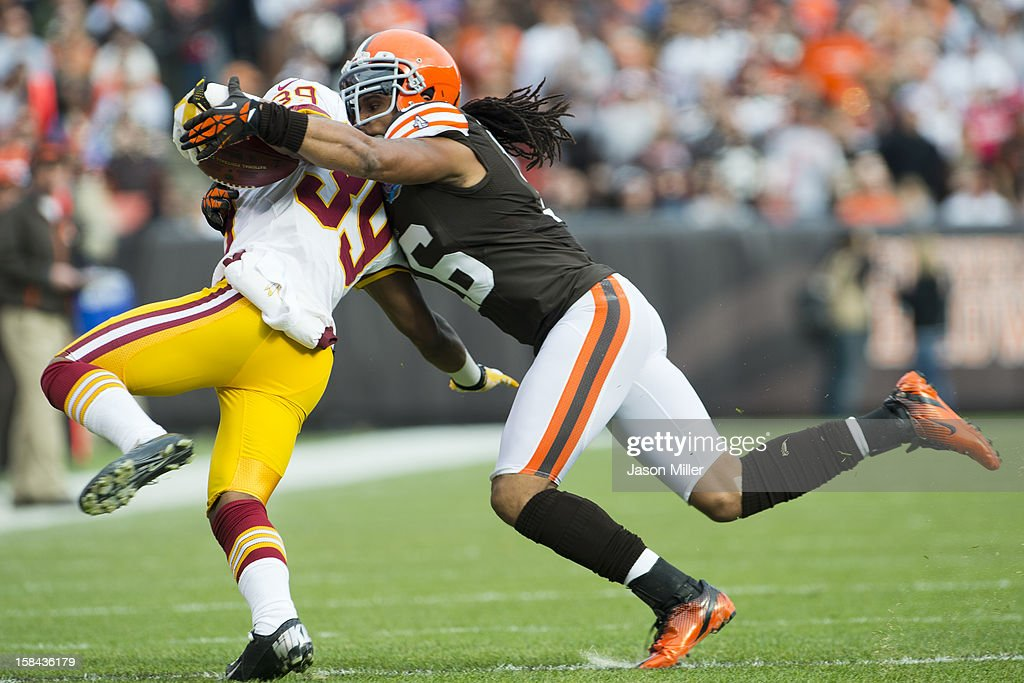Cornerback Richard Crawford #39 of the Washington Redskins is tackled by wide receiver Josh Cribbs #16 of the Cleveland Browns during the first half at Cleveland Browns Stadium on December 16, 2012 in Cleveland, Ohio.