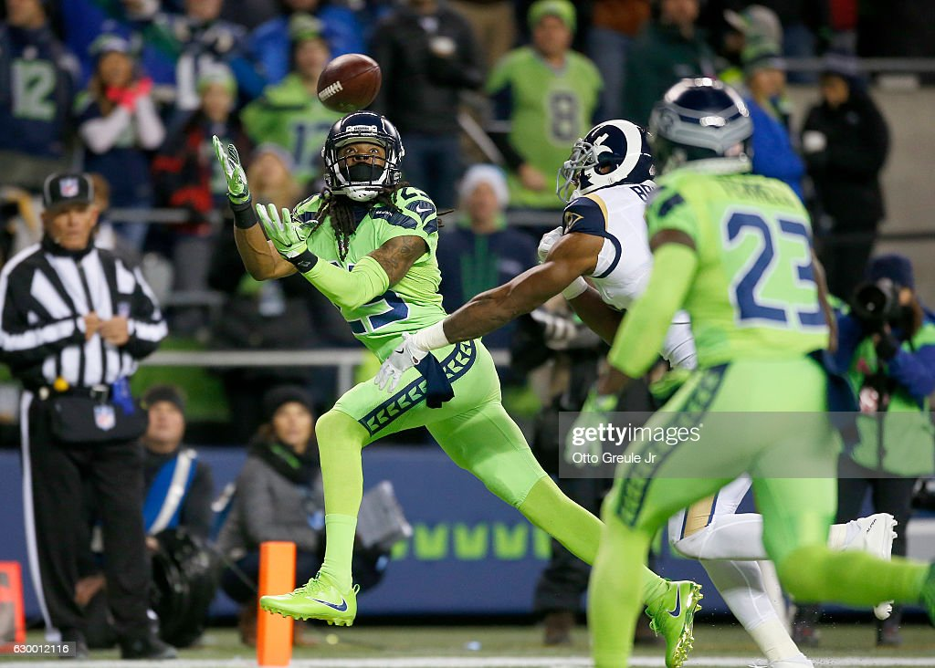 Cornerback Richard Sherman #25 of the Seattle Seahawks almost intercepts a pass by the Los Angeles Rams at CenturyLink Field on December 15, 2016 in Seattle, Washington.