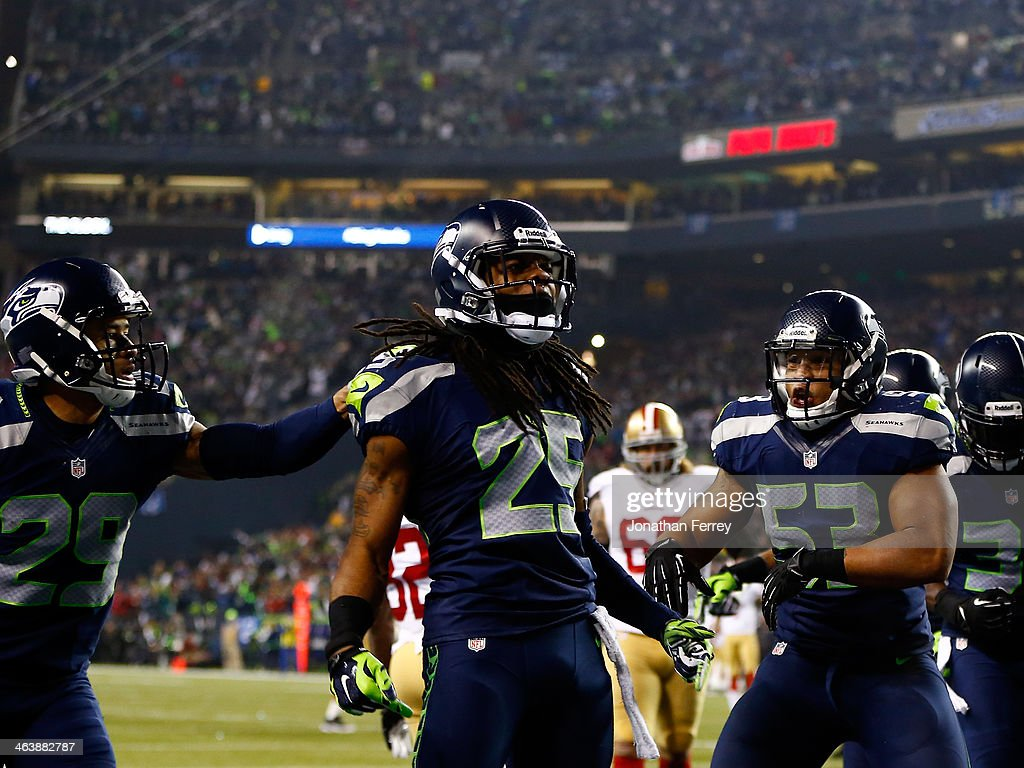 Cornerback Richard Sherman #25 of the Seattle Seahawks celebrates after he tips the ball leading to an intereption by outside linebacker Malcolm Smith #53 to clinch the victory for the Seahawks against the San Francisco 49ers during the 2014 NFC Championship at CenturyLink Field on January 19, 2014 in Seattle, Washington.