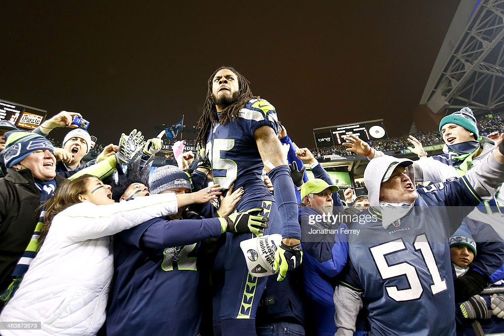 Cornerback Richard Sherman #25 of the Seattle Seahawks celebrates with fans after the Seahawks defeat the San Francisco 49ers 23-17 in the 2014 NFC Championship at CenturyLink Field on January 19, 2014 in Seattle, Washington.
