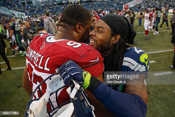 Cornerback Richard Sherman of the Seattle Seahawks is greeted by defensive end Calais Campbell of the Arizona Cardinals after the game at CenturyLink...