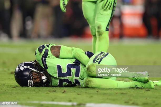 Cornerback Richard Sherman of the Seattle Seahawks reacts after an injury on a play in the second half of the NLF game against the Arizona Cardinals...