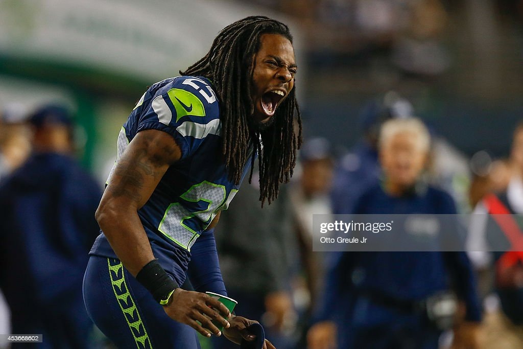 Cornerback Richard Sherman of the Seattle Seahawks reacts to a play against the San Diego Chargers at CenturyLink Field on August 15 2014 in Seattle...