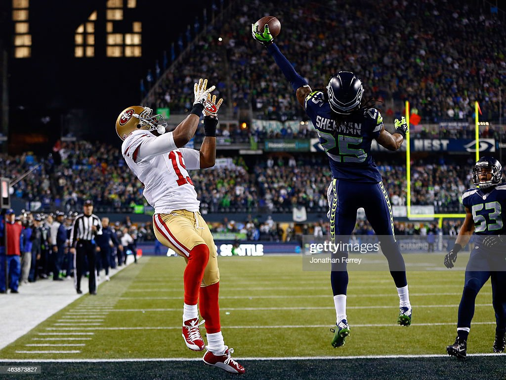 Cornerback <a gi-track='captionPersonalityLinkClicked' href=/galleries/search?phrase=Richard+Sherman+-+American+Football+Player&family=editorial&specificpeople=9857648 ng-click='$event.stopPropagation()'>Richard Sherman</a> #25 of the Seattle Seahawks tips the ball up in the air as outside linebacker Malcolm Smith #53 catches it to clinch the victory for the Seahawks against the San Francisco 49ers during the 2014 NFC Championship at CenturyLink Field on January 19, 2014 in Seattle, Washington.