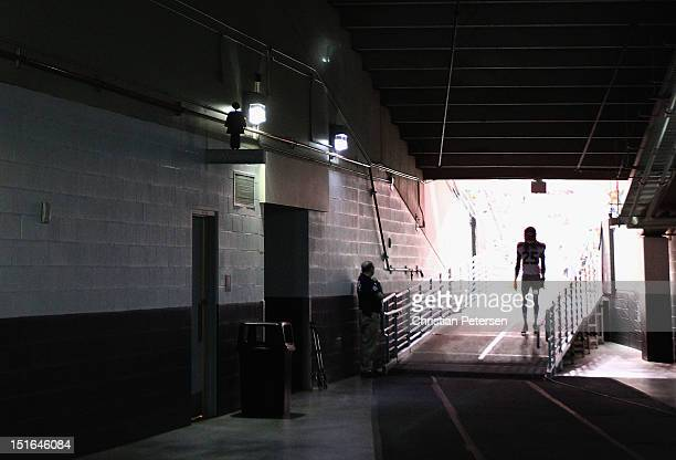 Cornerback Richard Sherman of the Seattle Seahawks walks out onto the field before the season opener against the Arizona Cardinals at the University...