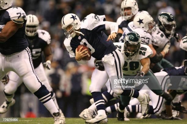 Cornerback Roderick Hood of the Philadelphia Eagles sacks quarterback Tony Romo of the Dallas Cowboys on December 25 2006 at Texas Stadium in Irving...