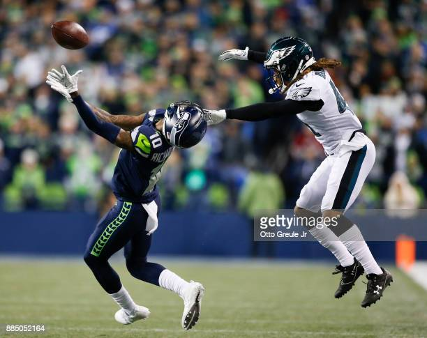 Cornerback Ronald Darby of the Philadelphia Eagles grabs at the helmet of wide receiver Paul Richardson of the Seattle Seahawks to cause an...