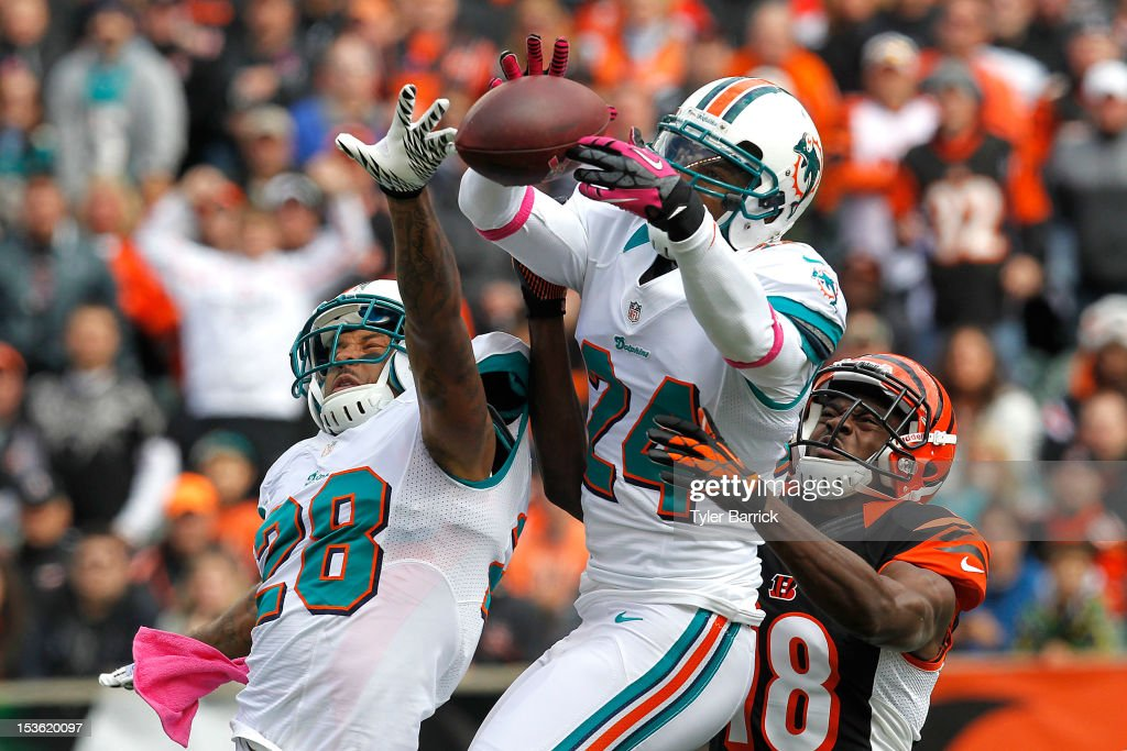 Cornerback Sean Smith #24 of the Miami Dolphins, bobbles a pass intended for <a gi-track='captionPersonalityLinkClicked' href=/galleries/search?phrase=A.J.+Green&family=editorial&specificpeople=5525868 ng-click='$event.stopPropagation()'>A.J. Green</a> #18 of the Cincinnati Bengals, at Paul Brown Stadium on October 7, 2012 in Cincinnati, Ohio.