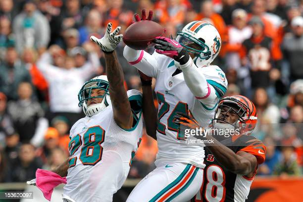 Cornerback Sean Smith of the Miami Dolphins bobbles a pass intended for AJ Green of the Cincinnati Bengals at Paul Brown Stadium on October 7 2012 in...