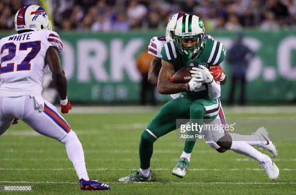 Cornerback Shareece Wright of the Buffalo Bills tackles wide receiver Robby Anderson of the New York Jets during the first quarter of the game at...