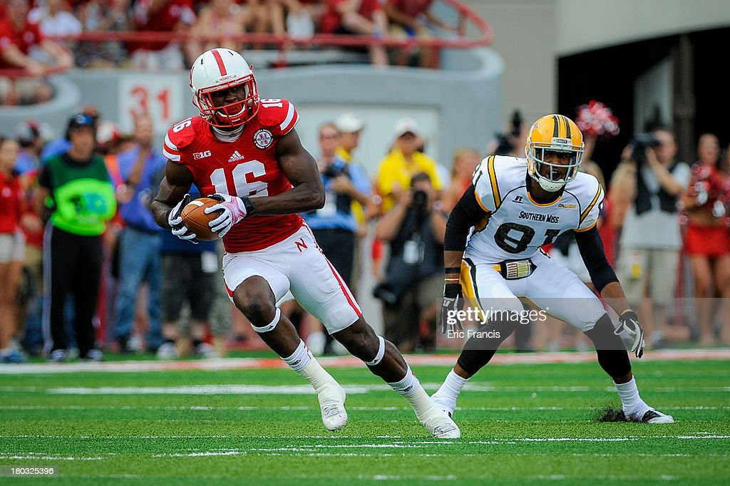 Cornerback Stanley Jean-Baptiste #16 of the Nebraska Cornhuskers intercepts a pass in front of wide receiver Rickey Bradley #81 of the Southern Miss Golden Eagles during their game at Memorial Stadium on September 7, 2013 in Lincoln, Nebraska.
