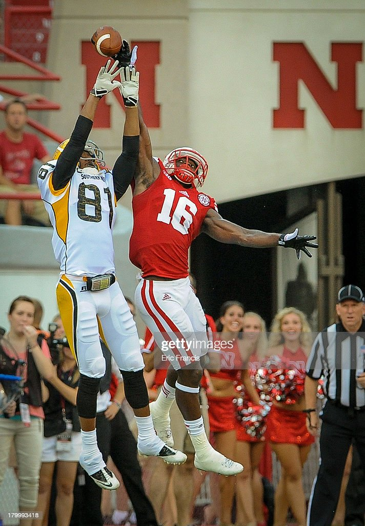 Cornerback Stanley Jean-Baptiste #16 of the Nebraska Cornhuskers fights for a pass with wide receiver Rickey Bradley #81 of the Southern Miss Golden Eagles during their game at Memorial Stadium on September 7, 2013 in Lincoln, Nebraska.