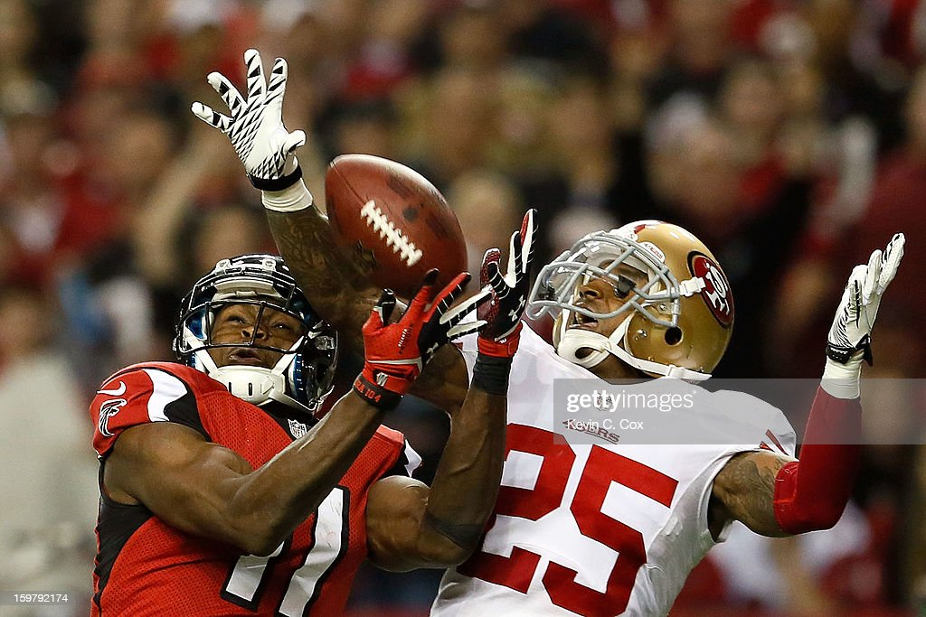 Cornerback <a gi-track='captionPersonalityLinkClicked' href=/galleries/search?phrase=Tarell+Brown&family=editorial&specificpeople=2105844 ng-click='$event.stopPropagation()'>Tarell Brown</a> #25 of the San Francisco 49ers breaks up a pass to wide receiver <a gi-track='captionPersonalityLinkClicked' href=/galleries/search?phrase=Julio+Jones&family=editorial&specificpeople=5509837 ng-click='$event.stopPropagation()'>Julio Jones</a> #11 of the Atlanta Falcons in the second half in the NFC Championship game at the Georgia Dome on January 20, 2013 in Atlanta, Georgia.