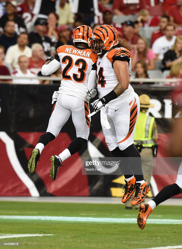 Cornerback Terence Newman and defensive tackle Domata Peko of the Cincinnati Bengals celebrate a touchdown during the first quarter of an NFL...