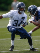 Cornerback Tharold Simon of the Seattle Seahawks defends during Rookie Camp at the Virginia Mason Athletic Center on May 11 2013 in Renton Washington