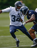 Cornerback Tharold Simon of the Seattle Seahawks runs through a drill during Rookie Camp at the Virginia Mason Athletic Center on May 11 2013 in...