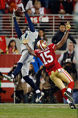 Cornerback Tharold Simon of the Seattle Seahawks tries to get his hands on a pass against wide receiver Michael Crabtree of the San Francisco 49ers...