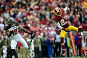 Cornerback Tracy Porter of the Washington Redskins and wide receiver Louis Murphy of the Tampa Bay Buccaneers are unable to come up with the ball...