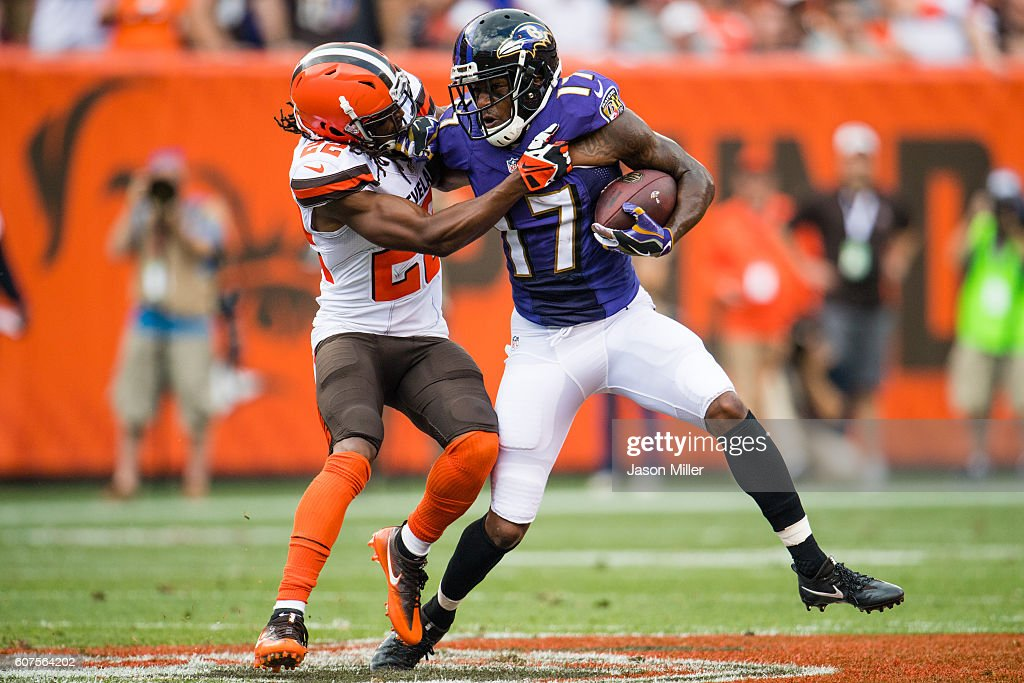Cornerback Tramon Williams #22 of the Cleveland Browns tackles wide receiver Mike Wallace #17 of the Baltimore Ravens at FirstEnergy Stadium on September 18, 2016 in Cleveland, Ohio.